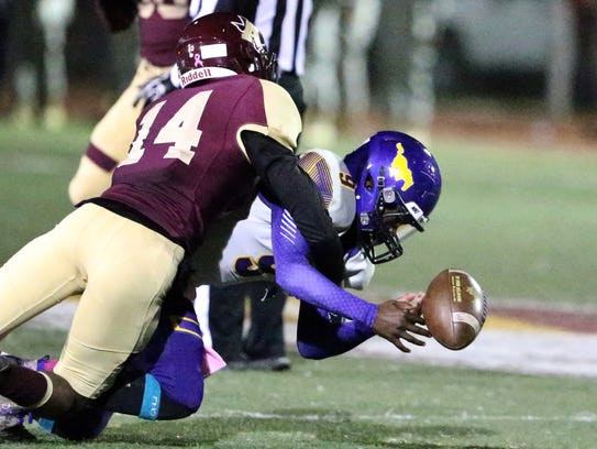 Burges wide receiver Tre Addy, 9, can't make the catch