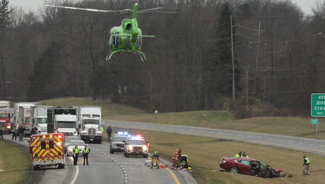 A Medflight helicopter takes off from the scene of a head-on car crash on U.S. 30 west of Rock Road in Ontario. The crash temporarily  closed down both lanes of traffic on Tuesday afternoon.