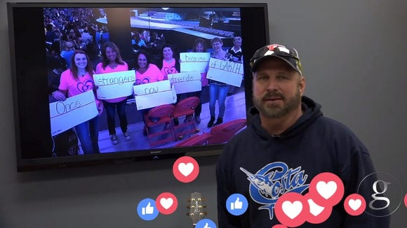 Amy Jacobs and her fellow fans behind Garth Brooks