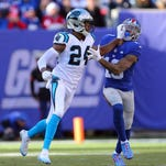 Dec 20, 2015; East Rutherford, NJ, USA; New York Giants wide receiver Odell Beckham Jr. (13) is defended by Carolina Panthers cornerback Josh Norman (24) during the first quarter at MetLife Stadium. Mandatory Credit: Brad Penner-USA TODAY Sports
