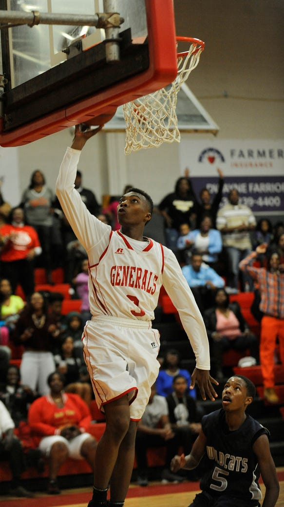 Lee's Roderic Scott (3) puts in a layup against Enterprise