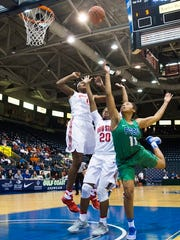 Florida Gulf Coast University junior, Erica Nelson, goes up for a shot as Ohio State University junior, Asia Doss, and Ohio State University freshman, Tori McCoy, rebound during game three of the Gulf Coast Showcase tournament at Germain Arena on Friday, November 25, 2016 in Estero, Fla. Ohio State University won and will be moving on in the tournament.