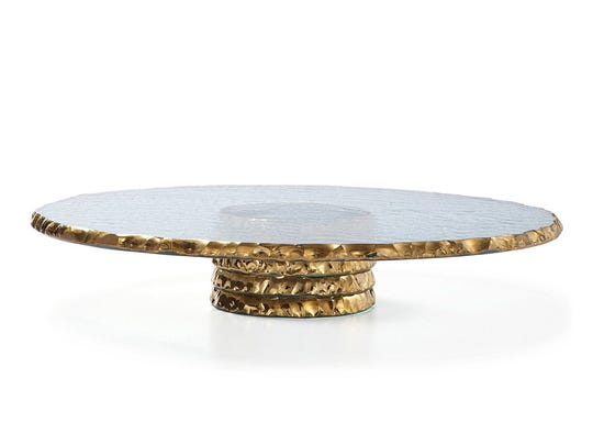 The edges of this Anniglass cake plate are covered with 24K gold.