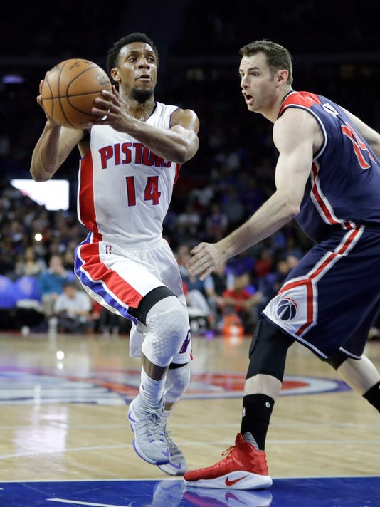 Detroit Pistons guard Ish Smith (14) drives on Washington Wizards forward Jason Smith during the first half of an NBA basketball game, Monday, April 10, 2017, in Auburn Hills, Mich. (AP Photo/Carlos Osorio)
