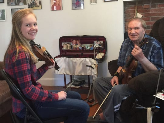 Student CarlyMae Buckner and legendary musician Arvil Freeman study the fiddle together at his Weaverville home
