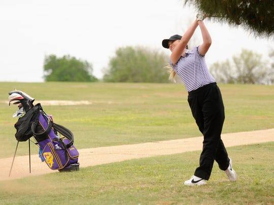 Wylie's Arin Zachary hits her second shot from No. 5 during the final round of the District 5-4A tournament at the Sweetwater Country Club on Monday, April 9, 2018. Zachary shot a third-round 71 to finish third individually.