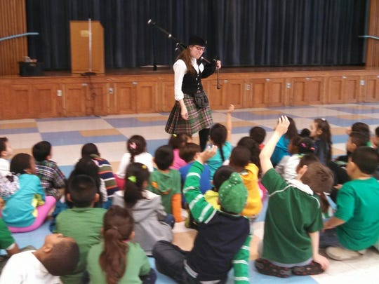 On St. Patrick's Day at North Plainfield's East End School, Kindergarten teacher Joanna Oliver invited her friend, Diane Leighton, to treat the school's pre-Kindergarten and Kindergarten classes to live bagpipe music. Leighton, who has played the bagpipe for 11 years, is part of the Cuchullain Pipe Band based in Morris County. She plays for crowds in parades, competitions, and other events all over the East Coast, and has played in Scotland and England with The Queen's Piper — the official bagpipe player for the queen of England. She also has played the bagpipes at East End School for the past four years on St. Patrick's Day. This year she played several holiday songs and informed the group about the bagpipes, how they work, and her experience as a member of a bagpipe band. Clad in an official kilted uniform, she explained its articles, and answered students' questions. The students were surprised to hear how loud the bagpipes are, and were delighted to see and touch the bagpipes and receive special St. Patrick's Day gifts from Leighton, according to a school news release.