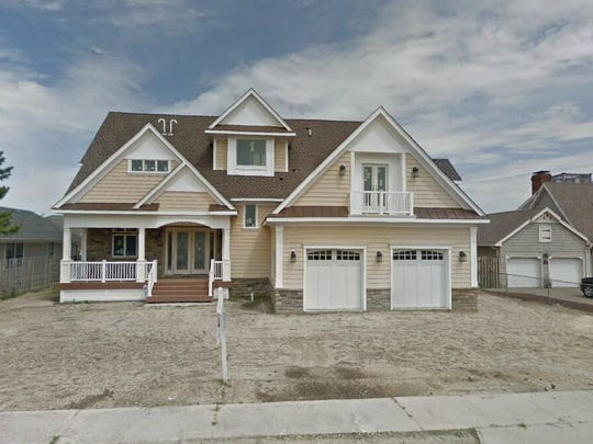 This Google Street View image shows the approximate location of 206 Valhalla Dr in Brick. The property at this address changed hands in May 2019, when Michael and Sarah Colantuono bought the property from Sonia Tacinelli for $1,475,000.