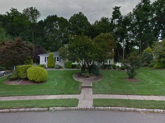 This Google Street View image shows the approximate location of 83 W{dot} Canadian Woods Road in Manalapan. The property at this address changed hands in May 2019, when Ricardo J and Nancy Oliveira  bought the property from Arthur S and Rosemarie Rosen  for $615,000.
