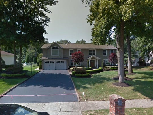 This Google Street View image shows the approximate location of 34 Westbrook Way in Manalapan. The property at this address changed hands in May 2019, when Joseph and Nancy Mirabile Maneri  bought the property from Henry and Lois Toker  for $725,000.