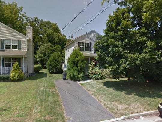 This Google Street View image shows the approximate location of 18 Carmen Place in Red Bank. The property at this address changed hands in March 2019, when  Kristen Desbiens  and  Timothy Ballard   bought the property from Thomas and Jody Tyson  for $410,000.