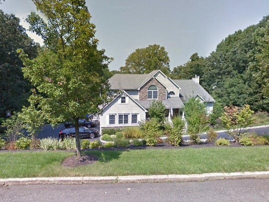 This Google Street View image shows the approximate location of 5 Overlook Drive in Holmdel. The property at this address changed hands in June 2019, when Scott and Vanessa Nied  bought the property from Vincent and Mary Tinebra  for $912,500.