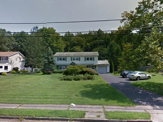 This Google Street View image shows the approximate location of 14 Winthrop Drive in Manalapan. The property at this address changed hands in May 2019, when  Brian A Garrett  and  Jennifer C Lauro   bought the property from  Kathleen Nowak  for $395,000.