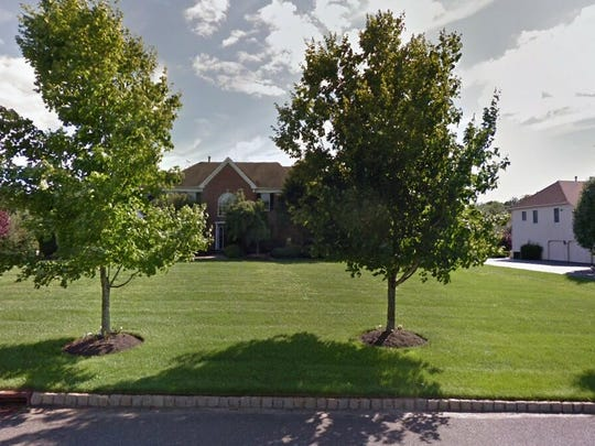 This Google Street View image shows the approximate location of 13 Quail Court in Manalapan. The property at this address changed hands in June 2019, when David B and Keri L Greenberg bought the property from Michael and Debra Fradkin for $963,500.
