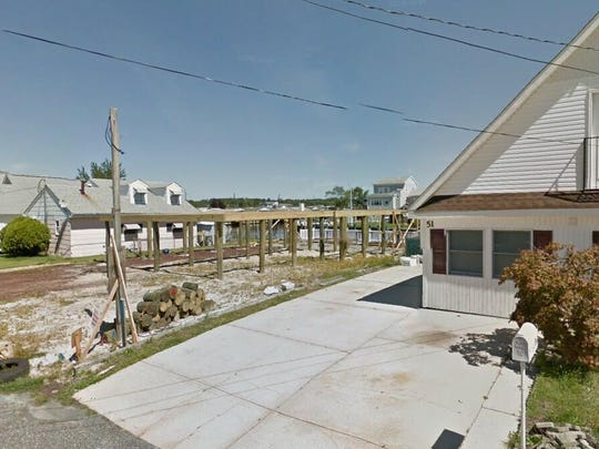 This Google Street View image shows the approximate location of 49 W. Anchor Drive in Little Egg Harbor. The property at this address changed hands in May 2019, when Angela and Chernitsky B Chernitsky bought the property from Carmine Cucunato Jr. and Kiersten L C Cucunato for $322,900.