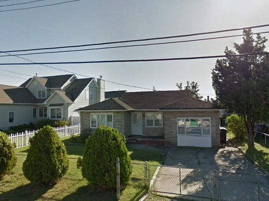 This Google Street View image shows the approximate location of 32 Wood Haven Road in Toms River. The property at this address changed hands in May 2019, when Kathleen Perkins-Czander bought the property from Dennis Smith for $235,000.