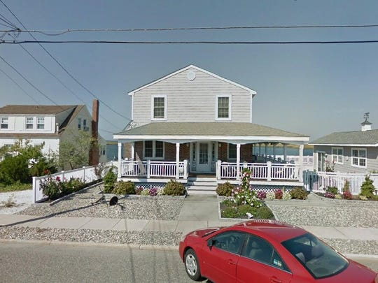 This Google Street View image shows the approximate location of 10415 Golden Gate Road in Stone Harbor. The property at this address changed hands in May 2019, when 10415 Golden Gate Drive LLC bought the property from James M Mcdermott Jr. and Maureen Mcdermott for $3,575,000.