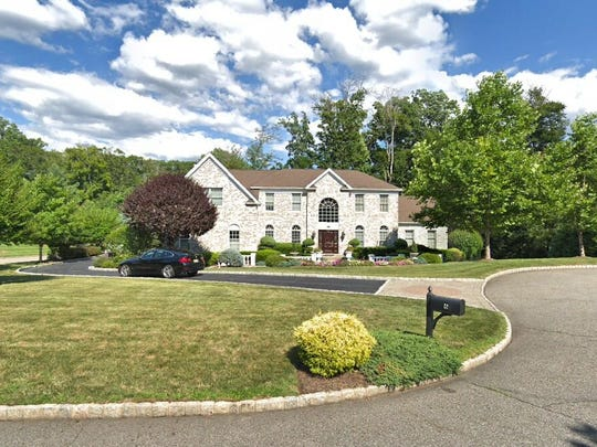This Google Street View image shows the approximate location of 6 Mulholland Drive in Woodcliff Lake. The property at this address changed hands in May 2019, when new owners bought the property for $1,177,000.