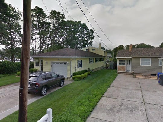 This Google Street View image shows the approximate location of 769 Manor Drive in Brick. The property at this address changed hands in July 2019, when new owners bought the property for $455,000.