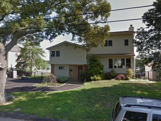 This Google Street View image shows the approximate location of 618 Harbor Road in Brick. The property at this address changed hands in June 2019, when new owners bought the property for $615,000.