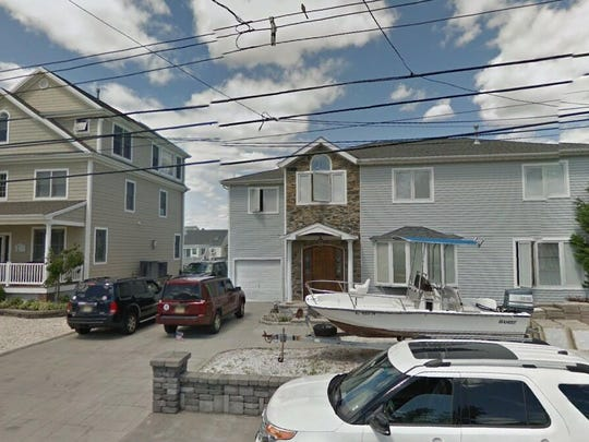 This Google Street View image shows the approximate location of 22 Point Road in Toms River. The property at this address changed hands in July 2019, when new owners bought the property for $660,000.