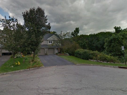 This Google Street View image shows the approximate location of 26 Guilford Court in Parsippany-Troy Hills. The property at this address changed hands in August 2019, when new owners bought the property for $460,000.