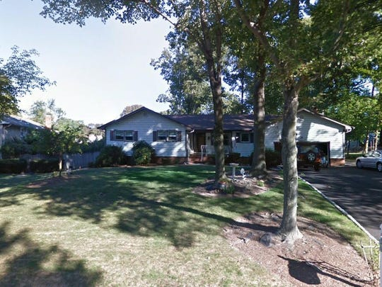 This Google Street View image shows the approximate location of 14 Holly Drive in Parsippany-Troy Hills. The property at this address changed hands in August 2019, when new owners bought the property for $460,000.