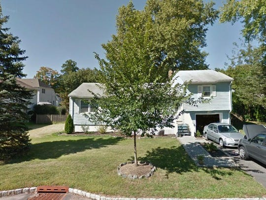 This Google Street View image shows the approximate location of 115 Elmwood Drive in Parsippany-Troy Hills. The property at this address changed hands in July 2019, when new owners bought the property for $392,000.