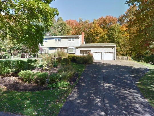 This Google Street View image shows the approximate location of 14 Woodbine Trl in Parsippany-Troy Hills. The property at this address changed hands in August 2019, when new owners bought the property for $645,000.