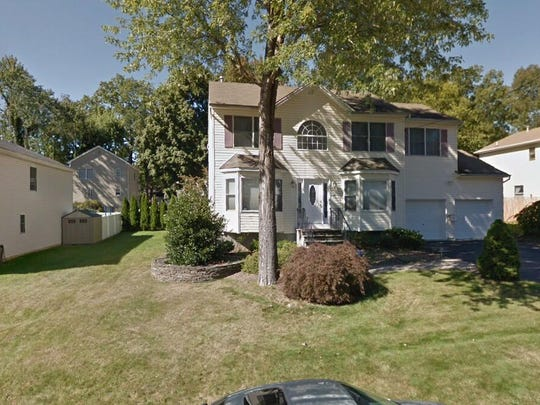 This Google Street View image shows the approximate location of 61 Flemington Drive in Parsippany-Troy Hills. The property at this address changed hands in October 2019, when new owners bought the property for $400,000.