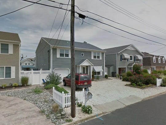 This Google Street View image shows the approximate location of 312 Cove Drive in Brick. The property at this address changed hands in August 2019, when the new owners bought the property for $840,000.