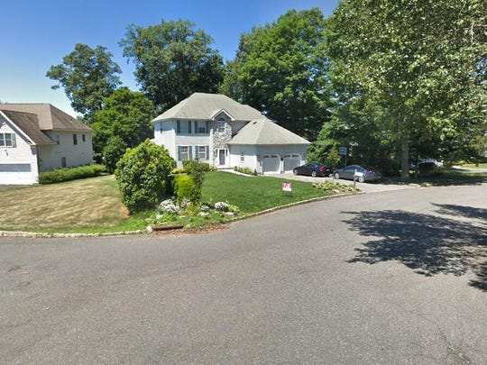 This Google Street View image shows the approximate location of 64 Wagon Trail in Mahwah. The property at this address changed hands in September 2019, when new owner bought the property for $875,000.