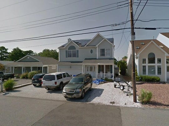 This Google Street View image shows the approximate location of 56 Jib Lane in Brick. The property at this address changed hands in December 2019, when the new owners bought the property for $502,500.