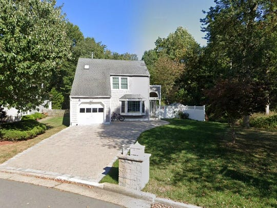 This Google Street View image shows the approximate location of 14 Woodland Way in South Brunswick. The property at this address changed hands in December 2019, when new owners bought the property for $345,000.