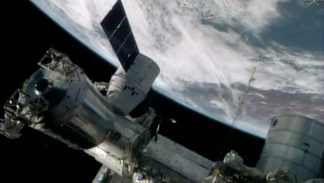 FILE- In this April 20, 2014, image made from a frame grabbed from NASA-TV, the SpaceX Dragon resupply capsule begins the process of being berthed on to the International Space Station. Astronauts hurriedly evacuated the U.S. section of the International Space Station and moved to its Russian module after a problem emerged Wednesday, Jan. 14, 2015, but Russian and U.S. officials insisted all six crew were not in any danger. (AP Photo/NASA-TV, File) ORG XMIT: NY112