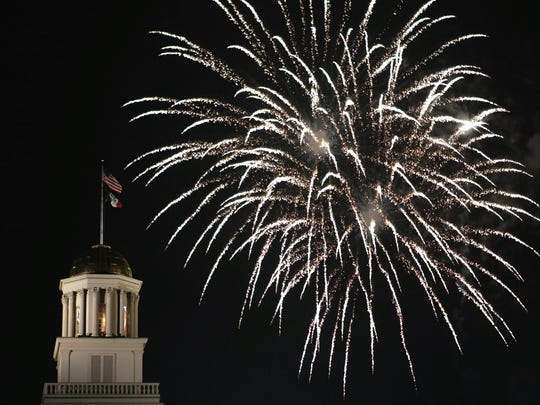 Fireworks are seen over the Old Capitol in downtown Iowa City.