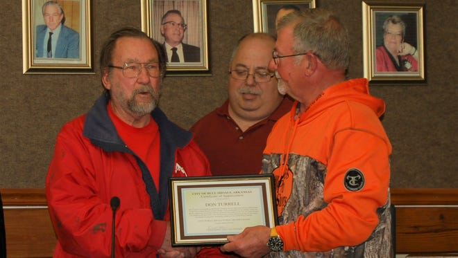 Al Kufeldt (far left), range master for the Winston L. Parkinson Archery Range in Bull Shoals, accepts a certificate of appreciation on behalf of archery range assistant Don Terrell on Thursday night at the Bull Shoals City Council meeting. Presenting the award is Mayor David Hotchkiss (center) and councilman Marty Nickels. The acrhcery range is located in Roy Danuser City Park in Bull Shoals and is free to use.