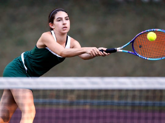 Morris Knolls' Lily Katzov hits a backhand during the