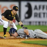 Southern Miss secondbaseman Nick Dawson (2) tags out a runner at second base Wednesday during the Golden Eagles' game against Ole Miss at Pete Taylor Park.