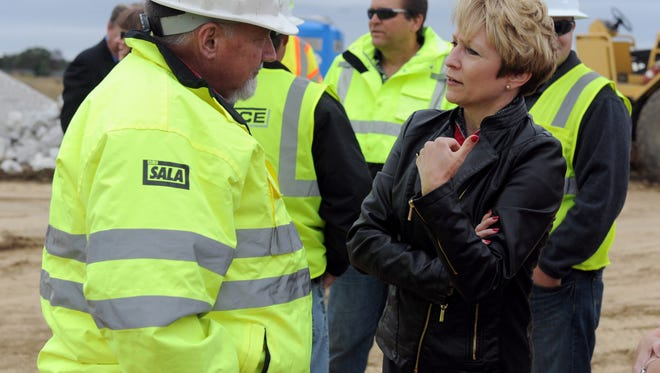 Indiana Lt., Gov., Sue Ellspermann speaks with Jim Albertson of Columbus Ind., who works for Force Construction Co., during Thursday's ground breaking ceremony on the Boonville Bypass project.  The $19.6 million project is expected to be completed by the end of 2017.