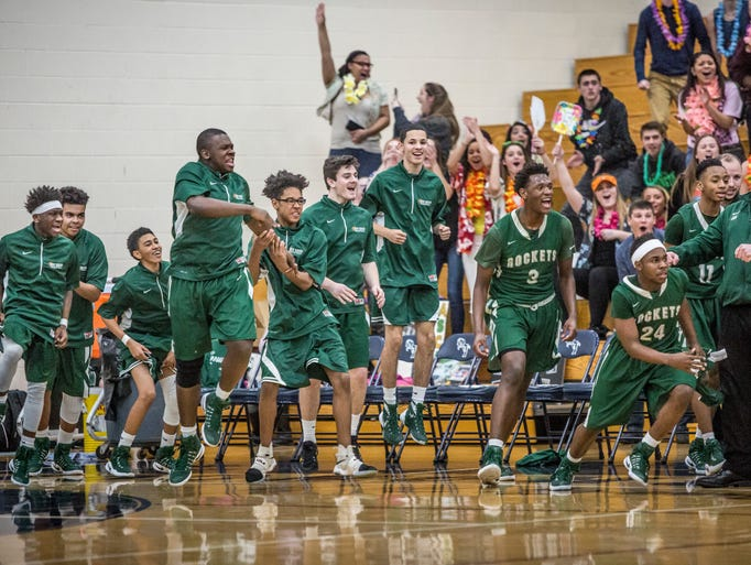 New Haven players jump off the bench after senior Eric