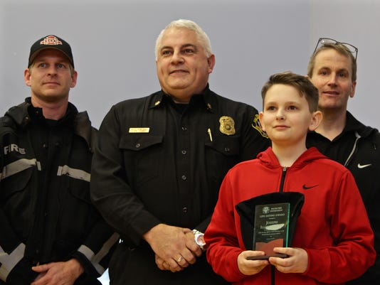 Straub Middle School student honoring for saving dad's life