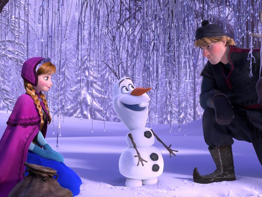"""This image released by Disney shows , from left, Anna, voiced by Kristen Bell, Olaf, voiced by Josh Gad, and Kristoff, voiced by Jonathan Groff in a scene from the animated feature """"Frozen."""" (AP Photo/Disney)"""