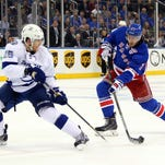 Ryan McDonagh of the Rangers takes a shot as Matt Carle of the Tampa Bay Lightning defends in Game One of the Eastern Conference Finals. McDonagh said his team needs to learn and respond to their 6-2 loss in Game Two of the series.