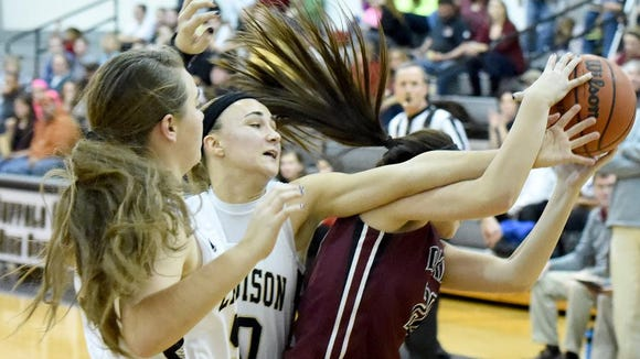 Buffalo Gap's Destiny Harper gets in on a battle for the rebound as Stuarts Draft's Danielle Brenneman comes away with the ball during a basketball game played in Swoope on Tuesday, Dec. 23, 2014.