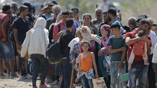 Refugees waiting to cross the border between Macedonia and Greece on Sept. 3, 2015.