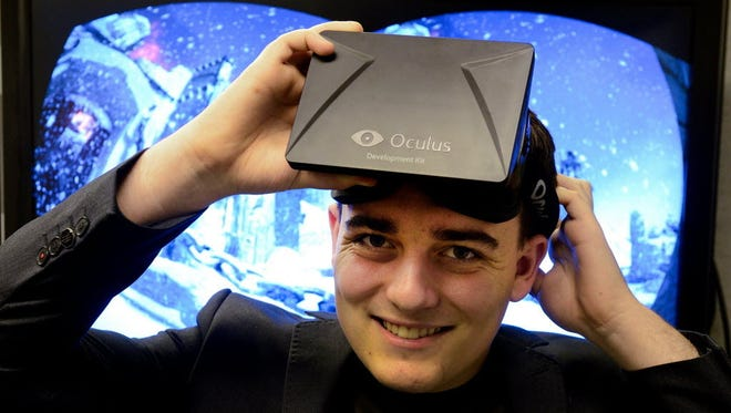 Palmer Luckey, shown here in 2013 shortly after creating the Oculus Rift VR goggle, tweeted Tuesday that he's on track to deliver the product to consumers in the first quarter of the new year.