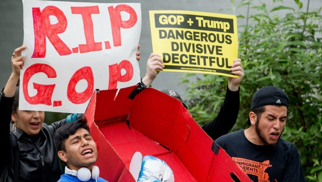 Protesters at the Republican National Committee headquarters on May 12, 2016.