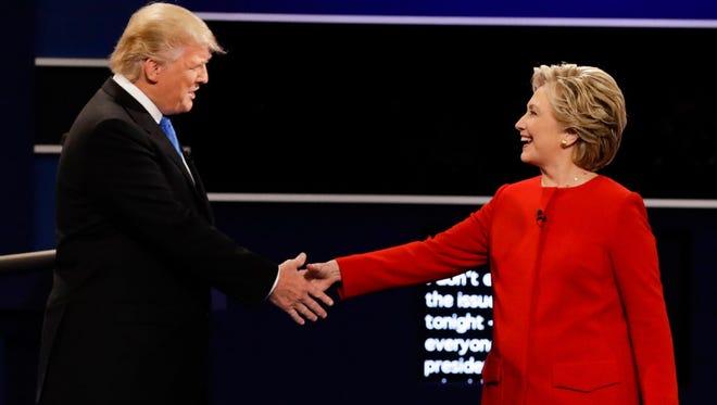 Republican presidential nominee Donald Trump and Democratic presidential nominee Hillary Clinton shake hands during the presidential debate at Hofstra University in Hempstead, N.Y., on Sept. 26.