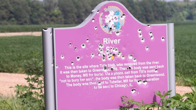 The sign that marks where Emmett Till's body was found in the Tallahatchie River has been riddled with bullets.